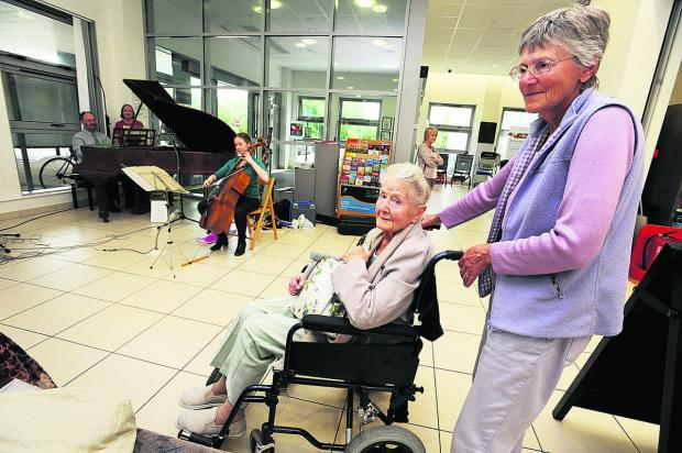 Lynda Forster and her mum Gladys Bury  enjoy music at Churchill Hospital Cancer Centre