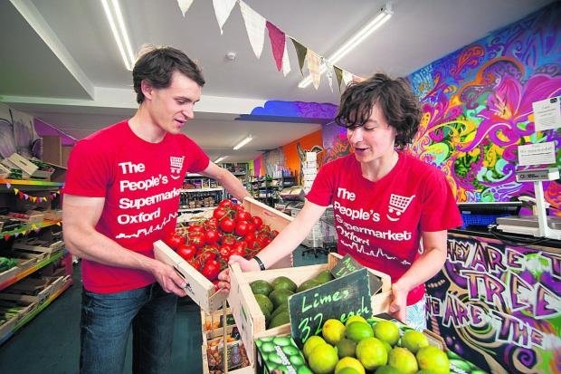 thisisoxfordshire: Hannah Hoechner and Huw Thomas at the People's Supermarket. Picture: OX60499 Andrew Walmsley