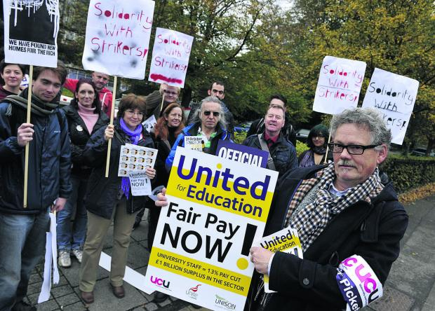 Staff at Oxford Brookes University, including Math Noorman, front right, were on the picket lines in Oxford yesterday as staff at both city universities joined the national strike last October