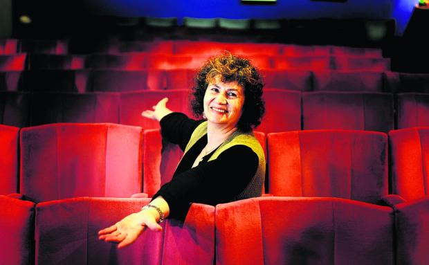 Becky Hallsmith, owner of the Ultimate Picture Palace, in the cinema's old seats