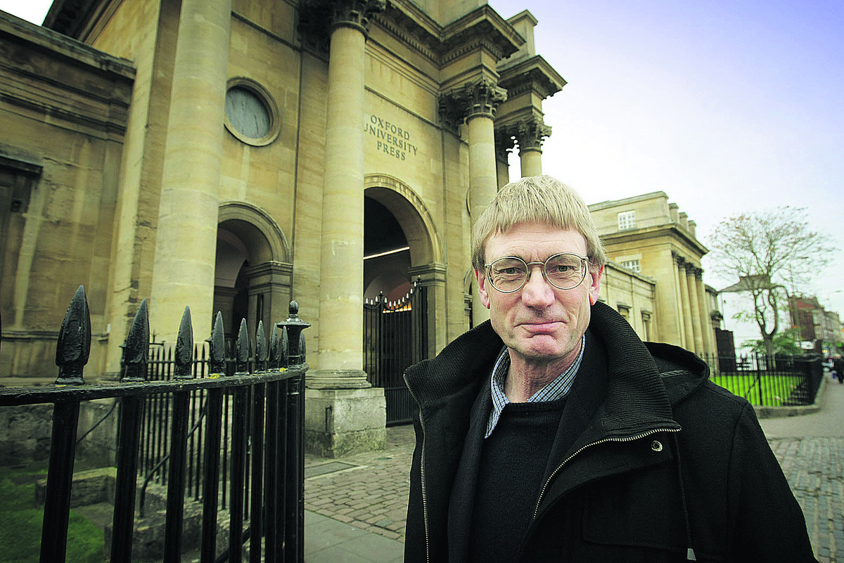 Simon Eliot, pictured outside OUP's headquarters in Walton Street, is masterminding the new history of the organisation