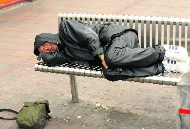thisisoxfordshire: HARD LIFE: A rough sleeper in Oxford city centre – aid agencies expect cuts to exacerbate the problem
