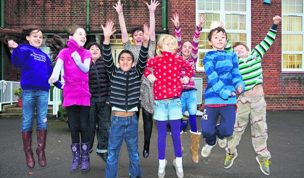 From left, pupils Fiona Jeffrey, nine, Saoirse Walsh, eight, Ismail Yalcin, eight, Abbas Hussain, eight, headteacher Clare Bladen, Abigail Bishop, eight, Leda Schenke, nine, Alan Lambert, nine, and Connor Bird, nine, while, below,Year Three teacher Gwen W