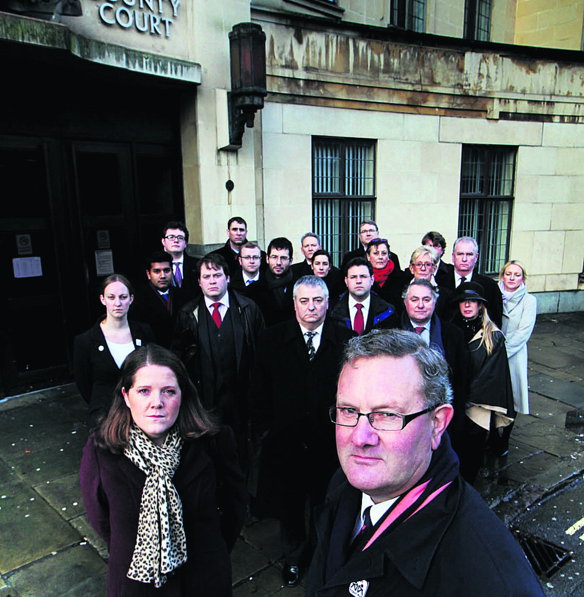 Barrister Nicholas Syfret, front, with other solicitors outside Oxford Crown Court