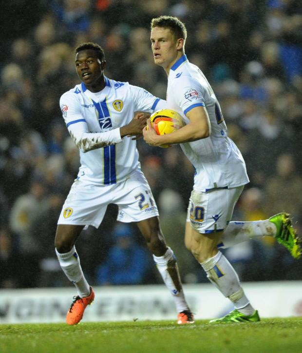 thisisoxfordshire: Gboly Ariyibi congratulates Matt Smith after he scored for Leeds against Blackburn     Picture: Jonathan Gawthorpe/Yorkshire Post