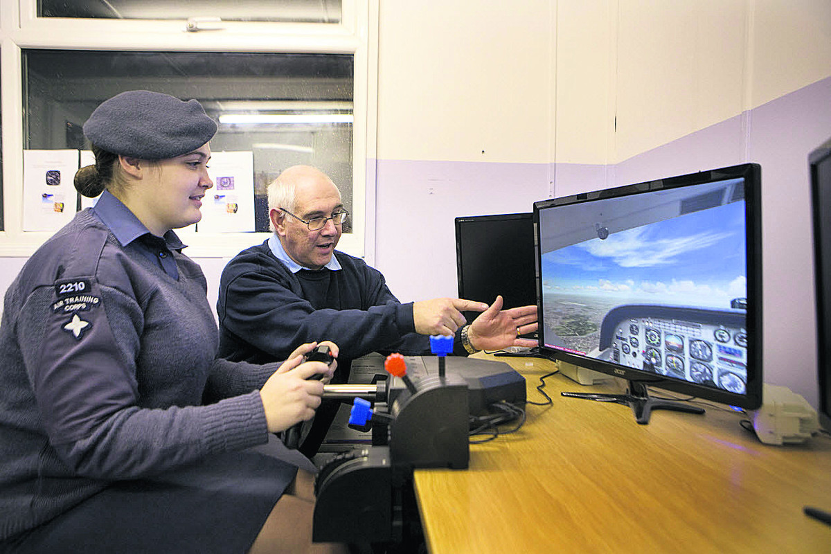 Cadet Lily August, 16, on the flight simulator with Chris Sims. Picture: OX64436