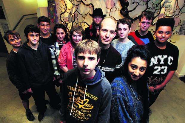 thisisoxfordshire: School friends Ryan Clune and Anusha Abbas have been campaigning against cuts set to be imposed on the Pegasus Theatre. Artistic director Jonathan Lloyd is pictured behind them.  Picture: OX64490 Ed Nix