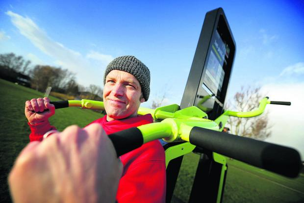thisisoxfordshire: City councillor Mark Lygo tests out the new equipment at Cowley Marsh Park Picture: OX64429 Damian Halliwell