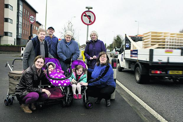 Cllr Jean Fooks, top right, with residents concerned by the number of drivers ignoring a left turn ban from the A40 Elsfield Way into Jackson Road.  Picture: OX64469  Ed Nix