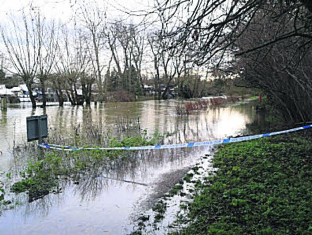 thisisoxfordshire: The flooded towpath near Osney Lock