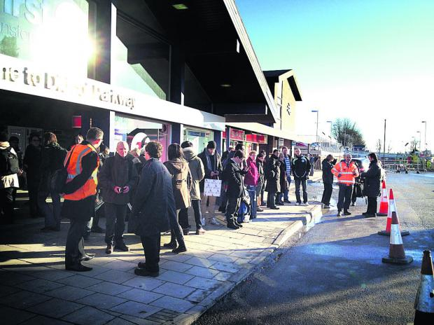 Queues of rail passengers outside Didcot Railway Station waiting for the replacment bus service afte