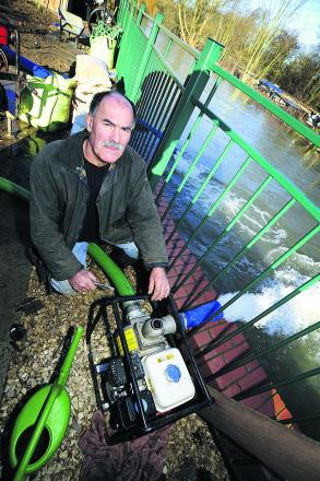 John Mastroddi, 64, helped his fellow residents in Kennington by installing water pumps at the end of his garden to pump water away from the houses.