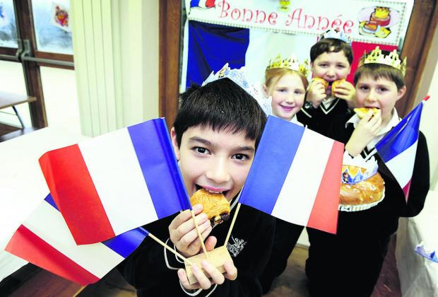 thisisoxfordshire: From left, Adam Suardi, nine, Penny Hodgson, 10, Giuliano Page, 10, and Barnaby Hindley, eight, enjoying French cakes and pastries at the school's G