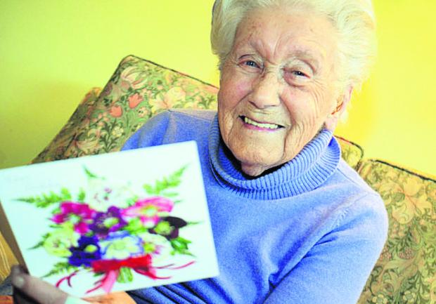 Sylvia Ritchie holds a card congratulating her on her grand age. Picture: OX64492 Marc West