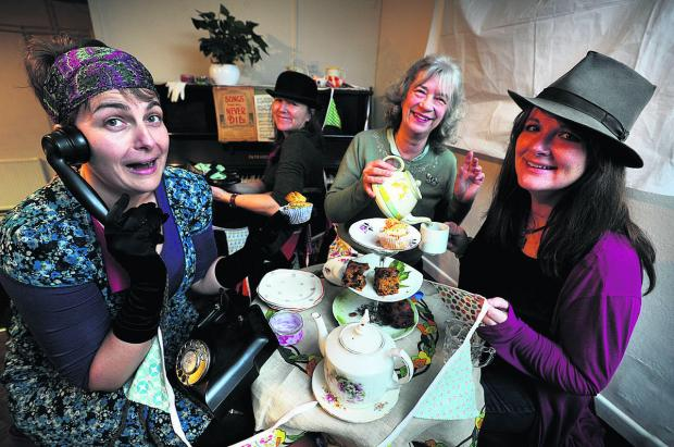 thisisoxfordshire: Stella Bell, Emily Marshall, Susan Hallett and Sara Reevell prepare for Saturday's tea dance