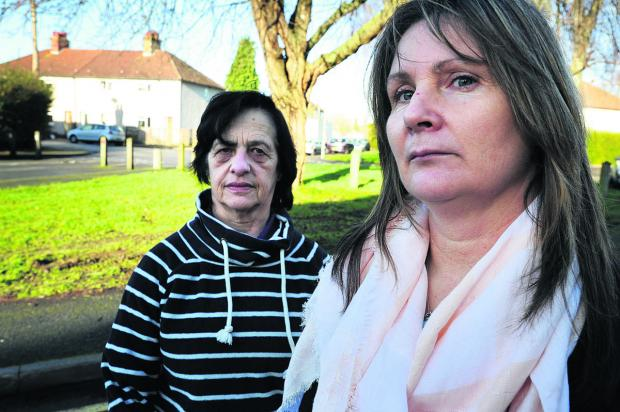 'STRUGGLE': Kerry Winfield, pictured right with neighbour Lilian Sherwood, claims the sale of her Fox Crescent home fell through because of the floods