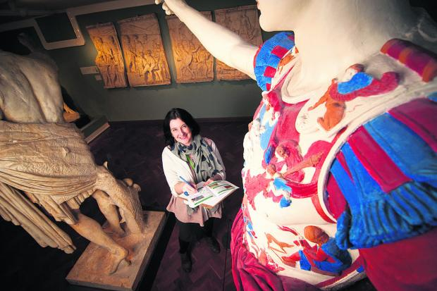 thisisoxfordshire: Jo Rice with the museum's painted cast of a Roman statue that features on one of the trails. Picture: OX64636 Andrew Walmsley