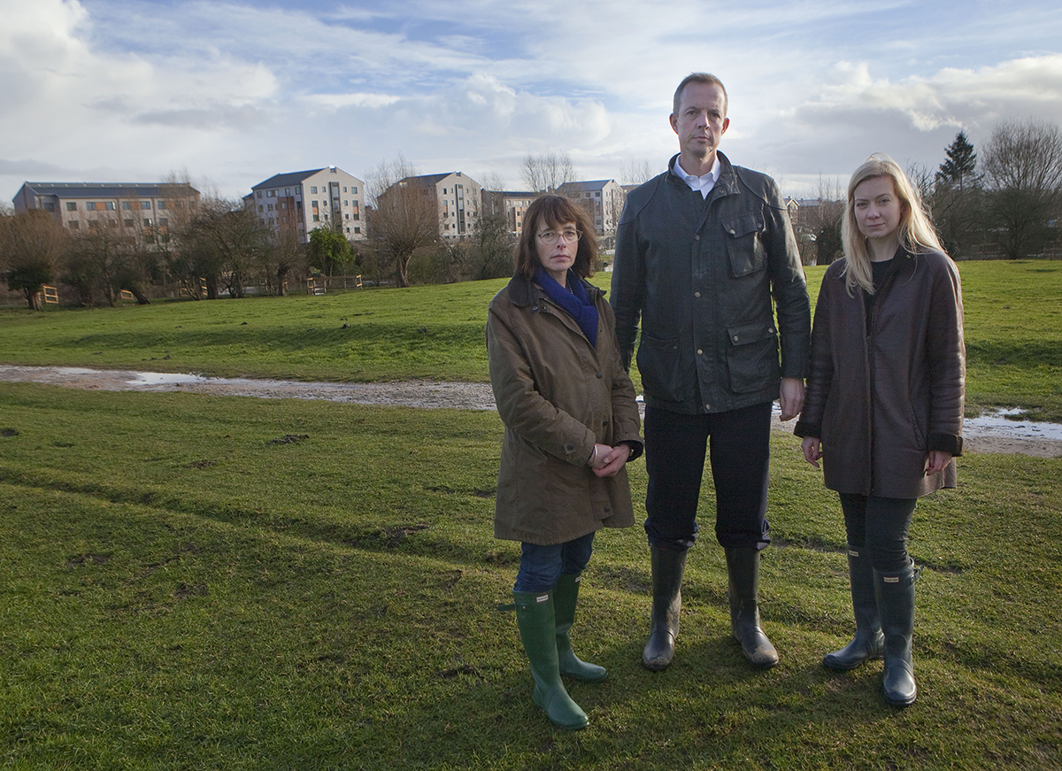Nicky Moeran, of Save Port Meadow, housing minister Nick Boles and Oxford West and Abingdon MP Nicola Blackwood with the controversial Castle Mill buildings in the background