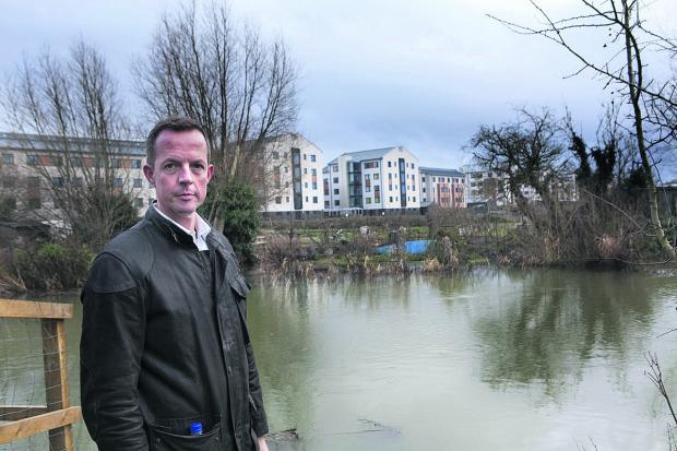 thisisoxfordshire: Nick Boles with the Castle Mill buildings in the background