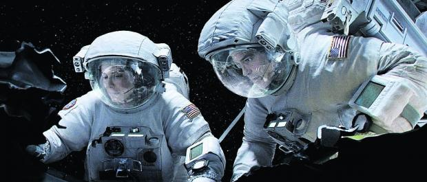 George Clooney and Sandra Bullock in a scene from the blockbuster film Gravit