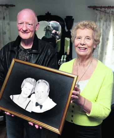 Mick Addinall presents Mary Blake with her competition prize of a sketch of her with her late husband Percy