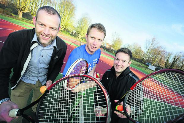 LOVE THE GAME: From left, councillor Mark Lygo, Joe Cartledge of Premier Tennis and Dave Reeve of the Lawn Tennis Association