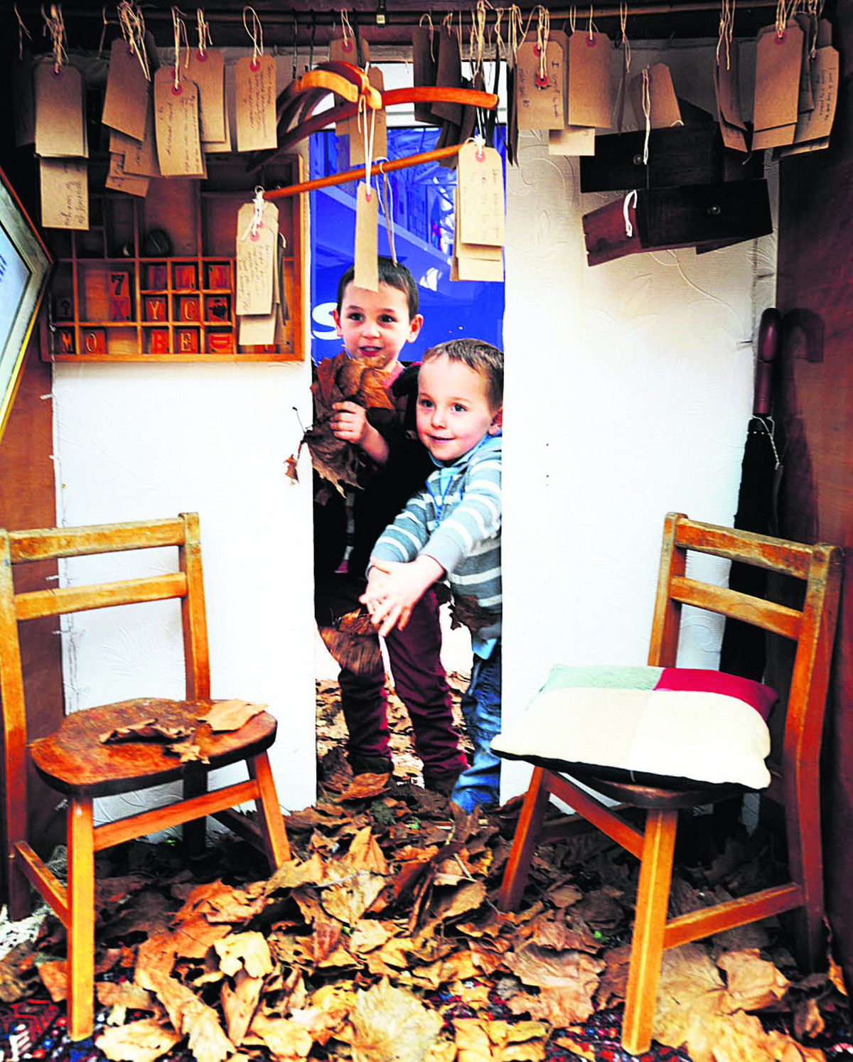 Exploring Cait Sweeney's wardrobe were Jack Reidy, four, left, and brother Olly, three. They were at the centre with their grandmother Diane Mortimer. Picture: OX64756 Jon Lewis