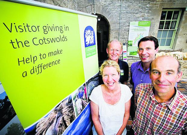 thisisoxfordshire: Chris Grimes, of Manor Cottages, is pictured, back, right, at the scheme's launch with, back, left, Nick Holliday, of the Cotswolds Sustainable Tourism Partnership, and, front, Susie Hunt, of Batsford Arboretum, and Harry Acland, of Notgrove Cottages