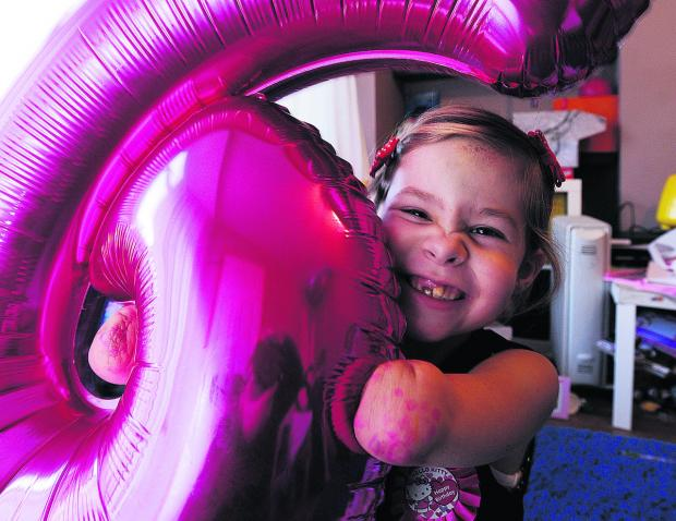 thisisoxfordshire: Charlotte Nott finds plenty to smile about on her sixth birthday