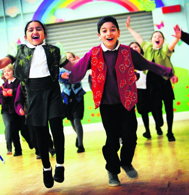 thisisoxfordshire: Year Three pupils including, front, Malu Jayakrishnan, seven, and Liyam Ghomshei, eight, take part in a Pegasus Theatre workshop at Sandhills Primary School which will culminate in a performance at the  theatre next week. Picture: OX64957 Ed Nix