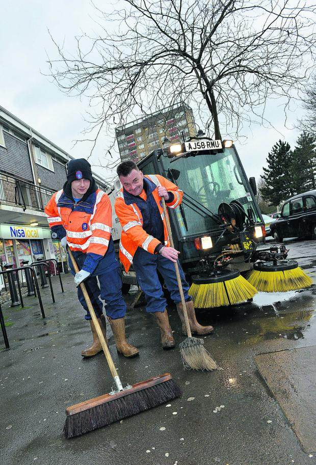 thisisoxfordshire: Streetscene operatives Kyle James, left, and Paul Knight cleaning up in Blackbird Leys ahead ahead of next week's clampdown. Picture: OX65003 Simon Williams