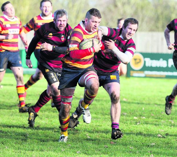 Bicester captain Dan Spencer powers past Hungerford's   former Oxford Harlequins player Anthony Cope