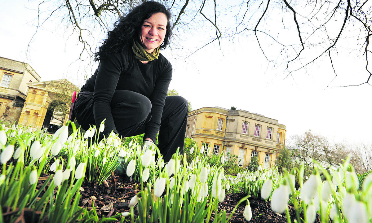Trainee botanic horticulturalist Vanessa Newman with snowdrops and blossoming witch hazel at the Botanic Garden. Picture: OX65045 Jon Lewis