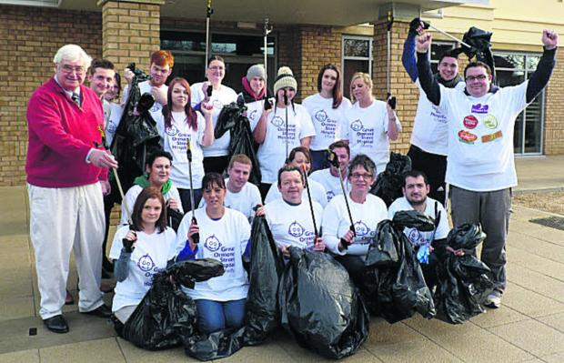 thisisoxfordshire: Councillor David Harvey, left, and hotel operations manager Sam Rowlands, right, with the litter-picking team from Witney's Premier Inn