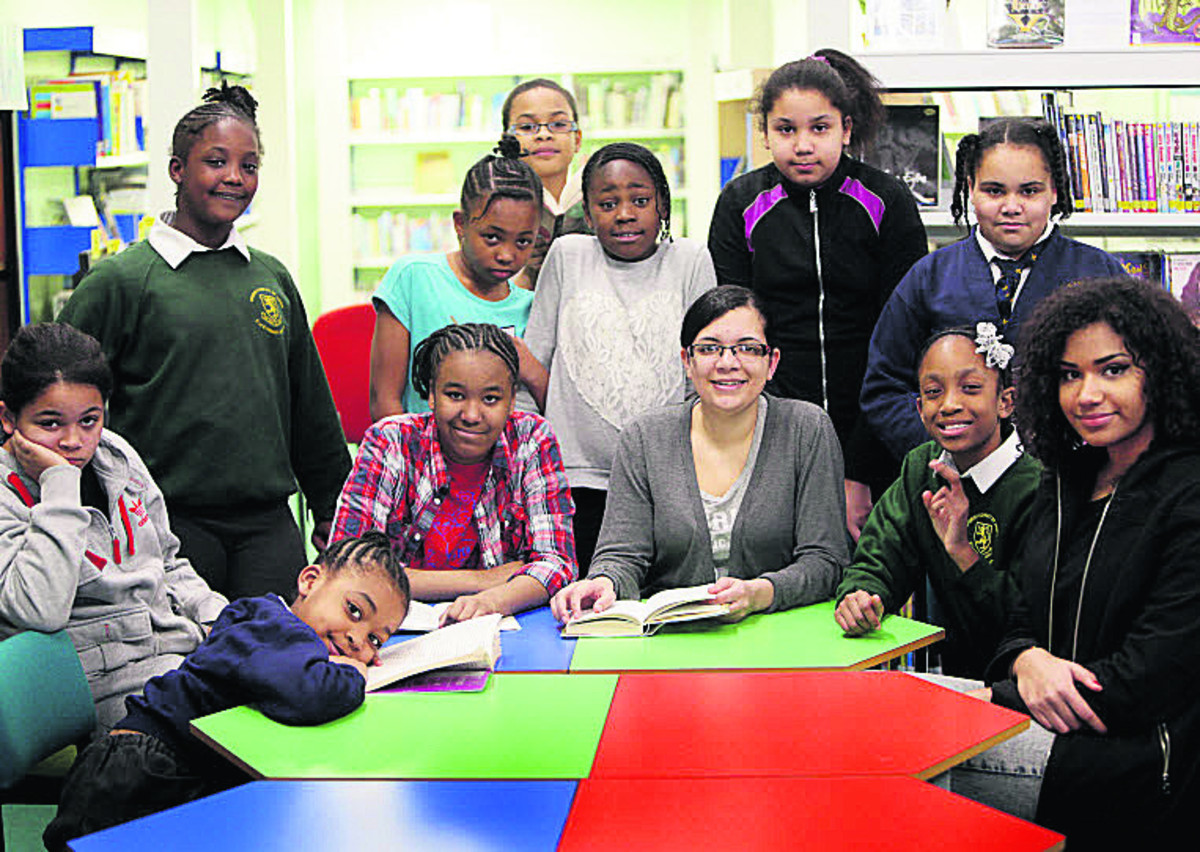 Youth worker, Sinnita Williams, centre, with girls who attended Arts Council England-funded literacy project at Blackbird Leys Library