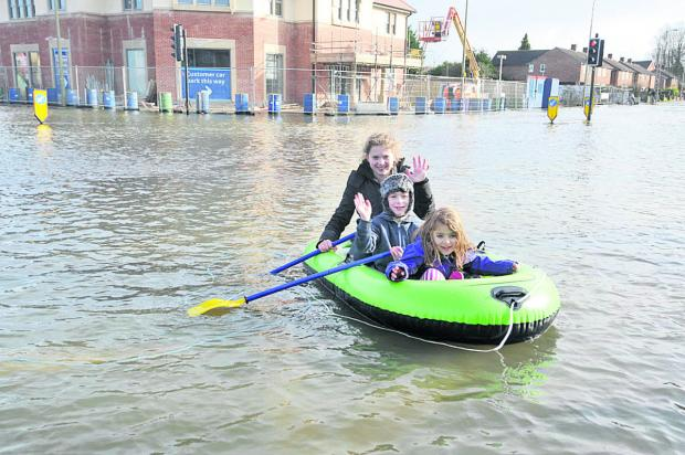 thisisoxfordshire: Two of Tim Bowley's children Isabella Bowley, 12, front and Lucia Bowley, six, rear, with friend Max Bridson in a dinghy in Abingdon Road