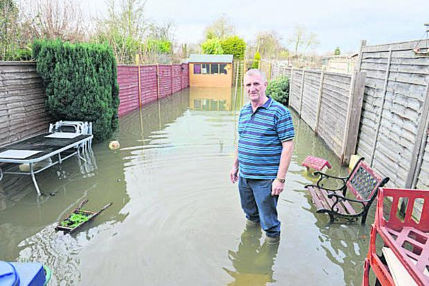 William Rankin in his flooded garden