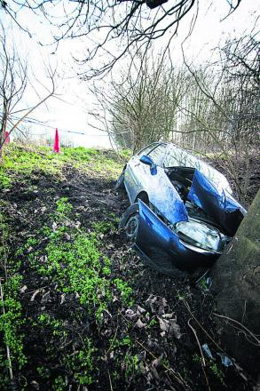 Police alerted after car crashes into tree