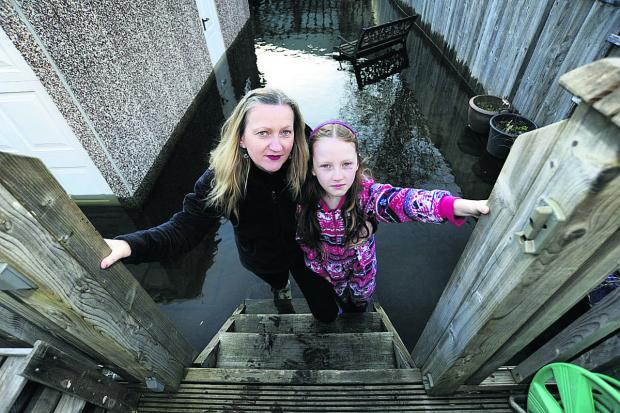 thisisoxfordshire: Lisa Barlow, 45, with her daughter Twiss, eight, in their back garden in Binsey Lane