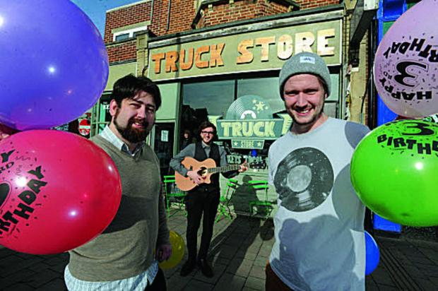 At the Truck Store, singer Jordan O'Shea, centre, with store manager Carl Smithson left, and sales assistant Euan Booth, right