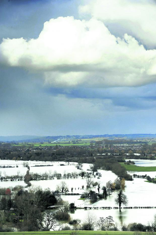 thisisoxfordshire: Views from Wittenham Clumps yesterday show flooded fields and footpaths, stretching from Little Wittenham and Day's Lock up towards Dorchester. Picture: OX65235 David Fleming