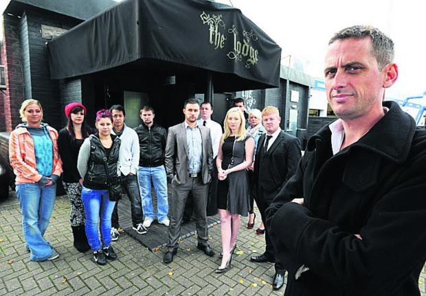 thisisoxfordshire: Owner Al Thompson and staff outside the club when the lap-dancing licence was revoked in 2012 Picture: OX54842 Jon Lewis