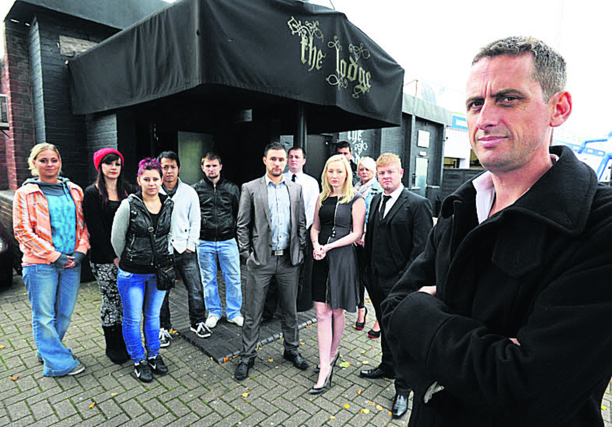 Owner Al Thompson and staff outside the club when the lap-dancing licence was revoked in 2012 Picture: OX54842 Jon Lewis