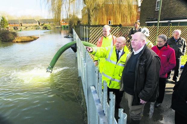 thisisoxfordshire: Eric Pickles, right, surveys the floods behind Bullstake Close, off Botley Road, with Oxfordshire County Council chairman Ian Hudspeth