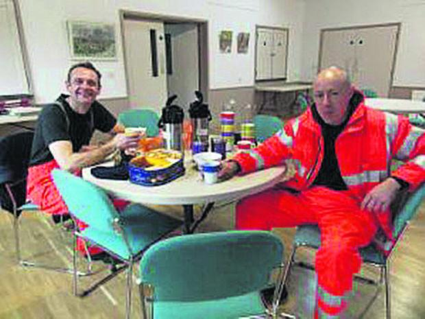 Firefighters take a break from pumping water at Abingdon Road