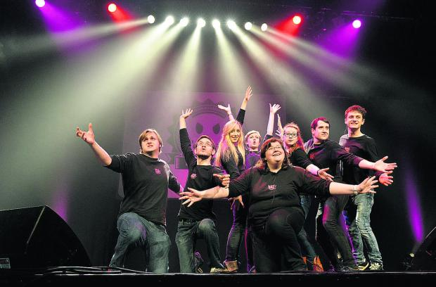 Members of the Imps on stage at the New Theatre