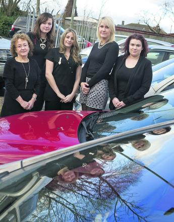 Michael & Company staff in the long stay car park – from left, Marion Kent, Lucy Thomas, Hannah Peedle, Rosie Weikert and Victoria Moss