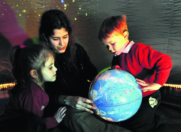thisisoxfordshire: Matina Payton of Explorer Dome, with Cutteslowe Primary School nursery class pupils Martyna Mackiewicz, five, and Lyndon Hanson, four