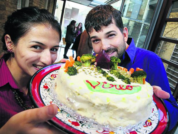 thisisoxfordshire: Aysegul Frame and her husband John Frame with their veggie cake. Picture: OX65356 Damian Halliwel