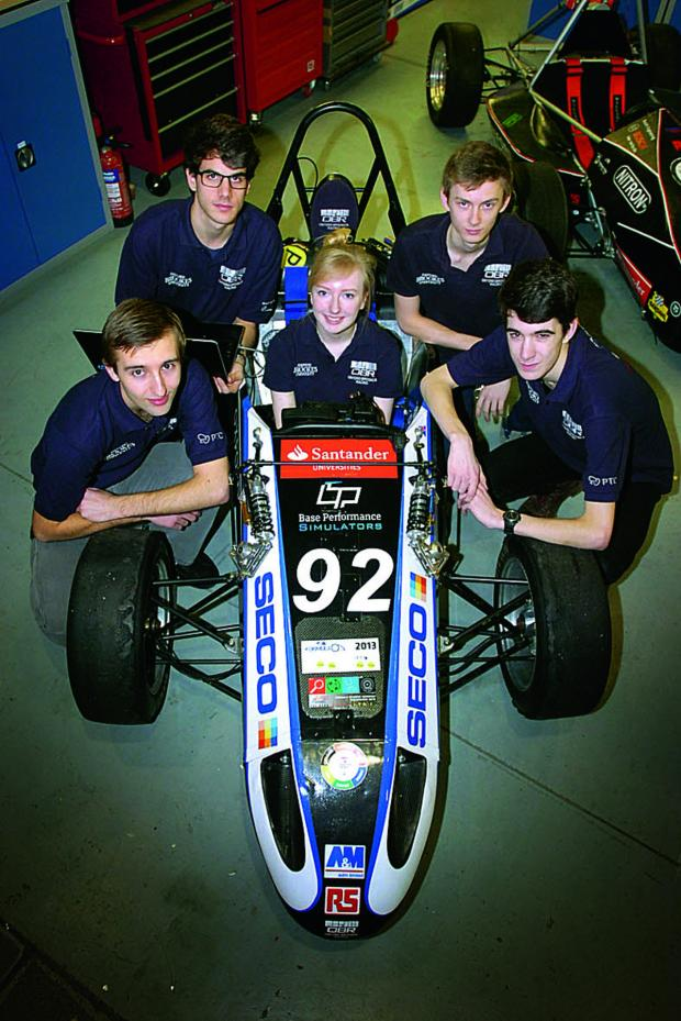 thisisoxfordshire: Oxford Brookes' Formula Student Racing Team with this year's car, from left Ben Sandy, Thomas Sans, Holly Watson Nall, George Simmons and Chris Shawe Picture OX65440: Lucy Ford